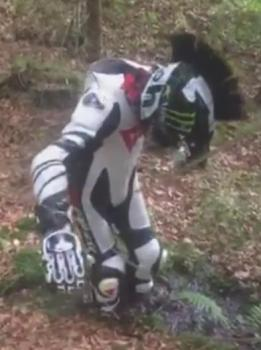 Movie censored: Biker with Dainese leather suit stuck in the mud in the forest