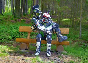 Biker on bench in the forest