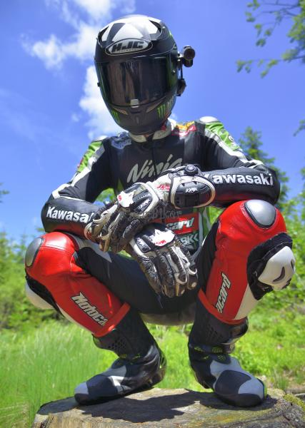 Biker on the road with Kawasaki leather suit 7